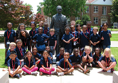 Students in the inaugural Horizons program learn campus history, including integration by James Meredith in 1962—represented here by a bronze statue sculpted by alumnus Rod Moorhead.