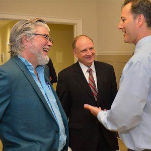 Chris Offutt (left), Dean Glenn Hopkins, and Associate Dean Richard Forgette | Photo by Robert Jordan/UM Communications