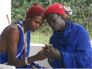 Maasai Moran (Warriors) learn to use the digital camera for photovoice research.