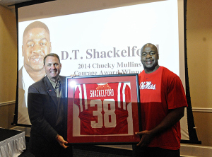 Deterrian Shackelford poses with Coach Hugh Freeze after being honored with the 2014 Chucky Mullins Award during a reception in Oxford, Miss., Saturday, April 5, 2014. | Photo by Thomas Graning