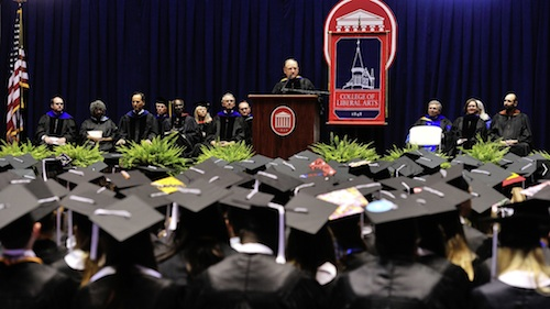 Dean Hopkins announces the 2014 Liberal Arts Teaching Awards at Commencement. | Photo by UM Communications
