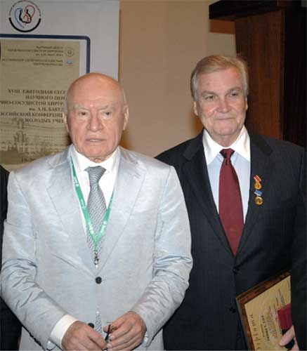 Dr. Cox with Dr. Leo Antonovich Bockeria, professor and chair of cardiac surgery at the Bakoulev Institute of Cardiac Surgery in Moscow, Russia at a conference of cardiac surgeons from around the world in May 2014.