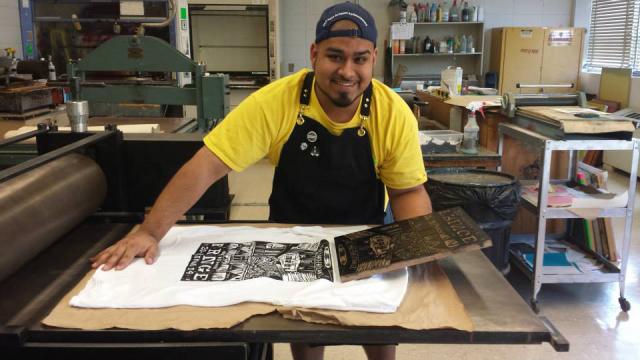 Frank Estrada in his print shop. | Photo courtesy of Estrada
