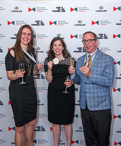 Tina Antolini (left), Sara Camp Arnold Milam and John T. Edge celebrate at the James Beard Awards in New York.