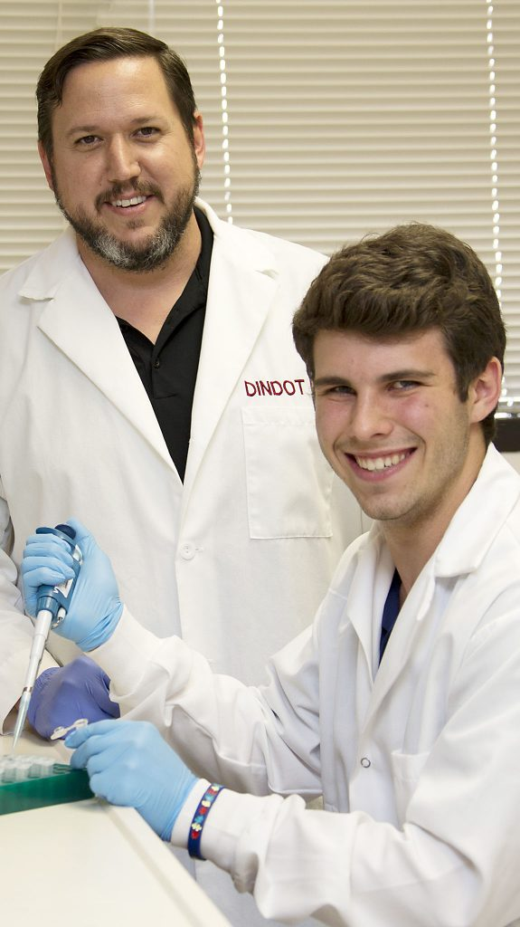 Scoot Dindot,left and Dylan Ritter in Dindot's lab.