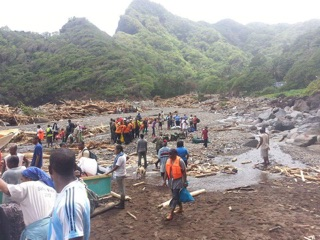 Dominicans inspect the remains of their flood-leveled dwellings.
