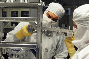 A UM physicist and graduate student make sure that LIGO equipment is working properly.