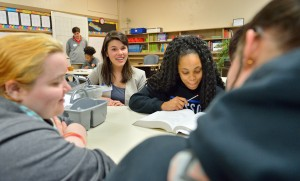METP fellow Emily Reynolds (center) works with Team 36 students at Coffeeville High School.