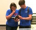 April Steen and Ryan Sessums (UM Chemistry and Biochemistry graduate students) participate in an ACS book club meeting.