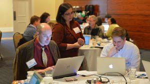 Ross Whitwam, Jocelyn Tipton, and Rachel Johnson work on Phase 1 of the Z-Degree program. Photo by Robert Jordan/Ole Miss Communications