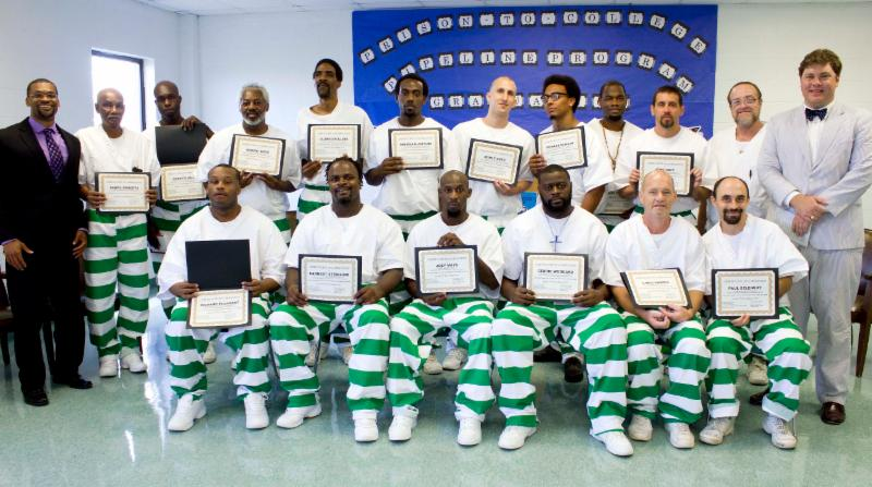 Patrick Alexander (far left) and Otis Pickett (far right) with the 2015 graduation class of the Prison-to-College Pipeline program at Parchman Prison. Photo courtesy of the Mississippi Department of Corrections.