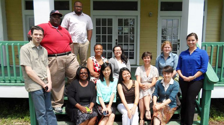 Faculty, staff, and students from both the University of Mississippi and the University of Michigan take a break after conducting community interviews for Visions of Hope, Inc. in Biloxi.
