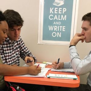 Josh Green (right), director of Independence High School's writing center, oversees a tutoring session with students Josh Figures and Martasia Copeland. Green reached out to the University of Mississippi – DeSoto Writing Center for resources and ideas. Submitted Photo