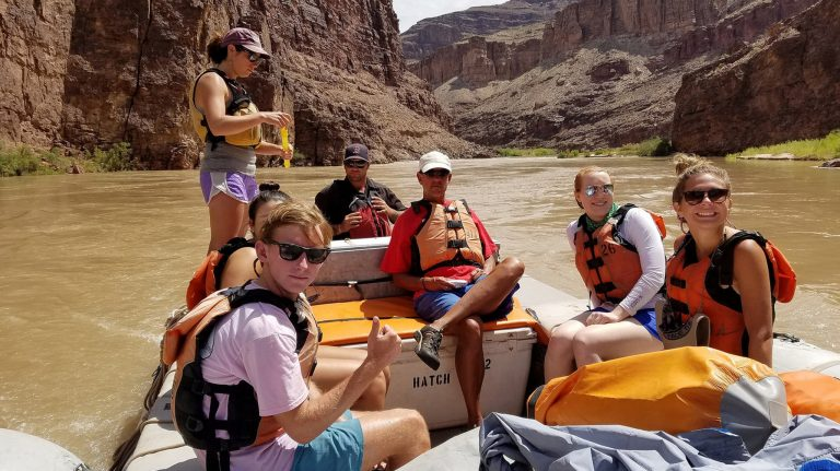 Ben Bradford (left) and Anna Daniels (behind) relax with their tour guides and fellow students Eveanne Eason (second from right) and Sally Boswell as they float down the Colorado River during their visit to the Grand Canyon. Photo courtesy James Asbill