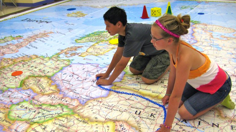 Middle school students spend some time interacting with the National Geographic Giant Map of Europe. The map is touring selected cities across Mississippi. Photo courtesy of Mississippi Geographical Association