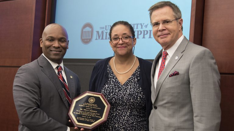 Willa Johnson (center), UM associate professor of sociology, receives the IHL Excellence in Diversity Award. She is congratulated by (from left) IHL trustee Shane Hooper and Chancellor Jeffrey Vitter. Submitted photo