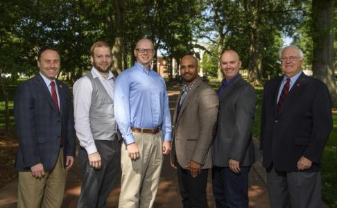 Dean Lee Cohen, far left, and Associate Dean Charles Hussey, far right, congratulate UM's 2017 College of Liberal Arts New Scholars. They are, from left to right, Jared Delcamp, Joshua Hendrickson, Derrick Harriell and Matthew Wilson. Thomas Graning/Ole Miss Communications