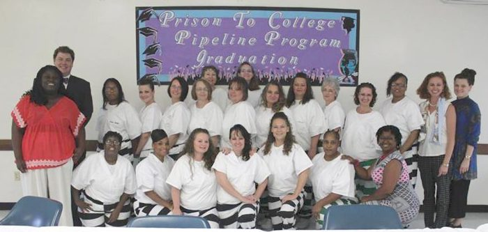 Co-teachers Otis Pickett (back row, left) and Stephanie Rolph (back row, second from right) with the 18 graduates of the summer 2016 Prison-to-Pipeline course at Central Mississippi Correctional Facility. Submitted photo/Mississippi Department of Corrections.