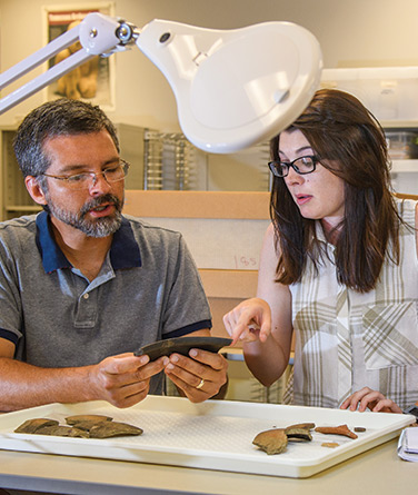 Tony Boudreaux with archaeology graduate student Allie Smith