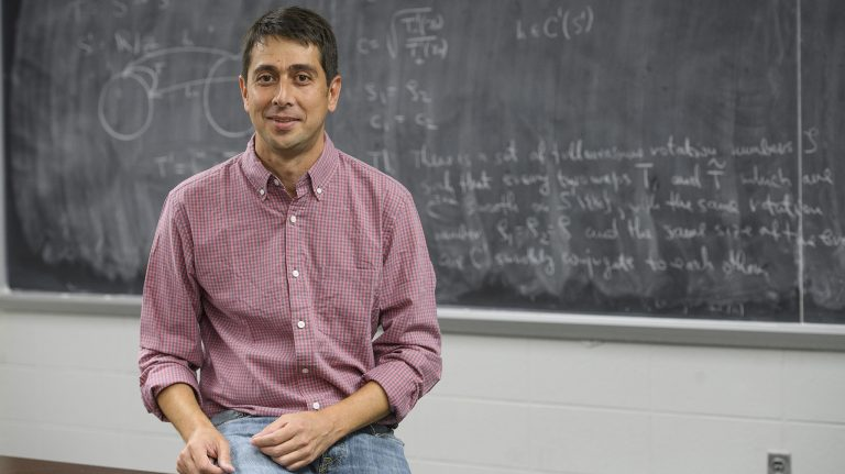 Saša Kocić, UM assistant professor of mathematics, is continuing his study of dynamic systems and mathematical physics, which promises to help scientists better understand such diverse phenomena as heart function and stock market fluctuations. Photo by Thomas Graining/Ole Miss Communications