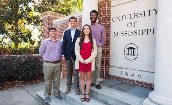 University of Mississippi alumnus Jimmy Carr of Oxford, Mississippi, second from left, greets the recipients of two scholarships he and his wife, Amanda, established to help students achieve their educational goals. Tyler Weaver, left, and Xakylan Johnson, right, both of Oxford, are the recipients of the Jimmy Carr State Farm Scholarship while Michelle Terracina of Greenville, Mississippi, received the Judy Carr Scholarship, established in honor of Carr's mother.
