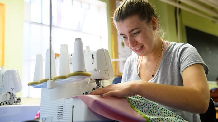 Hannah Bosworth, a freshman theatre arts major from Coronado, California, sews a dress for St. Peter's Episcopal Church's Little Dresses Ministry as part of her Introduction to Costumes for the Stage class at UM. Photo by Robert Jordan/Ole Miss Communications