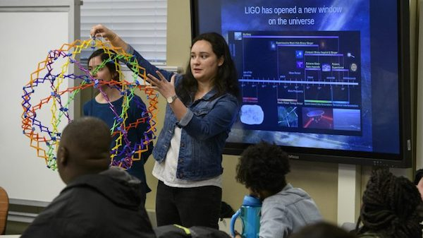 Undergraduate physics major Renee Sullivan-Gonzalez demonstrates the big bang to Mississippi high school students involved with the Global Teaching Project program. Photo by Thomas Graning