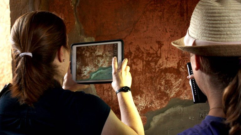 Rebecca Benefiel, an associate professor of classics at Washington and Lee University and Ancient Graffiti Project director, uses an iPad to photograph graffiti in Herculaneum, Italy. Submitted photo