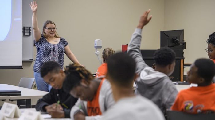 Audra Parsons, a graduate student in the Center for Mathematics and Science Education, instructs RUBI students during a recent classroom session. Photo by Thomas Graning/Communications