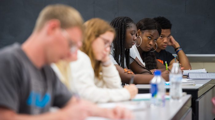 Participants in the Mississippi Bridge STEM Program take notes in a class led by UM mathematics instructor Kelvin Holmes. Photo by Kevin Bain