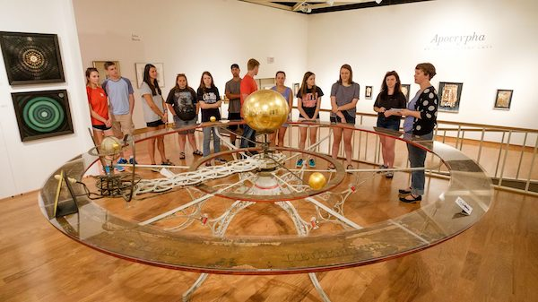 Students view Barlow's Planetarium while on display at the UM Museum. Photo by Robert Jordan