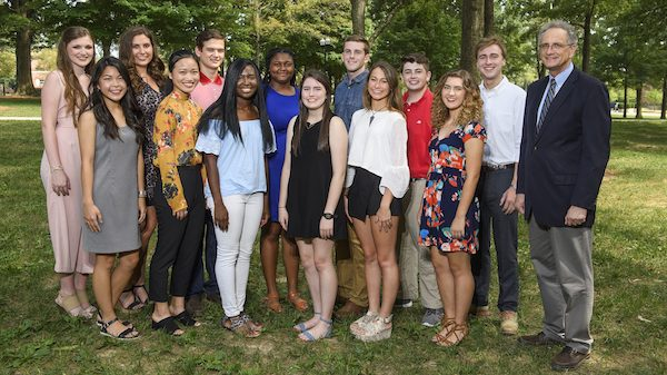 Douglass Sullivan-Gonzalez (right), dean of the Sally McDonnell Barksdale Honors College, meets with Honors scholars (from left) Autumn Fortenberry, Brithney Ngo, Ella Endorf, Ivy Li, deYampert Brame Garner II, Kayci Kimmons, Ajah Singleton, Emily Wright, Samuel Starr, Arabella Hamm, Kaden Spellmann, Hayden Williamson and Andrew Gardner. Photo by Thomas Graning/UM Digital Imaging Services