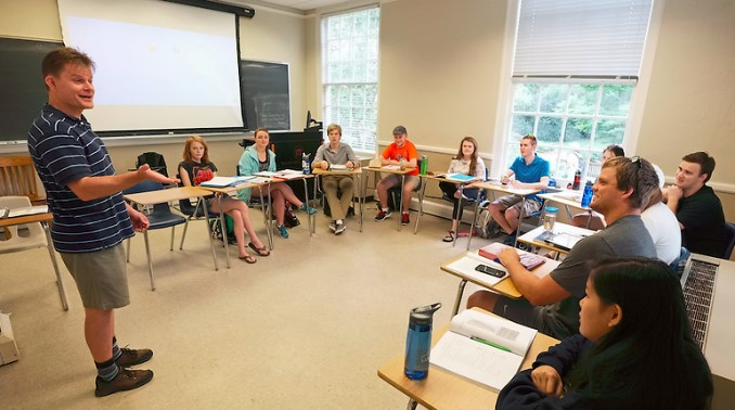 Allen Clark (at board), co-director of the UM Arabic Language Flagship Program, teaches an intensive Arabic class. In its first year as a Language Flagship Program, the UM Arabic program achieved a 100 percent acceptance rate for its students into the prestigious capstone year. Photo by Robert Jordan/Ole Miss