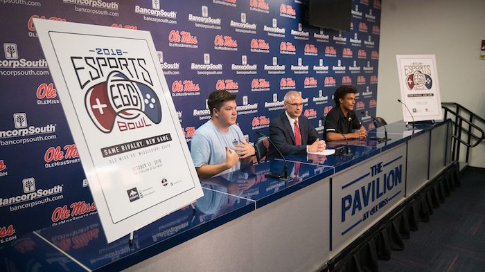 At left, Cray Pennison, president of the Ole Miss Esports club, is joined by Noel Wilkin, University of Mississippi provost and executive vice chancellor, and Jason DeShong, president of MSU Esports, to announce the Esports Egg Bowl set for Sat., Oct. 13, in The Pavilion at Ole Miss. Photo by Kevin Bain.