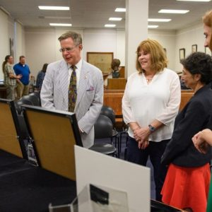 Chancellor Jeffrey Vitter (left) and his wife, Sharon, look over a recent addition to the Department of Archives and Special Collections with library Dean Cecilia Botero and Jennifer Ford, head of special collections.