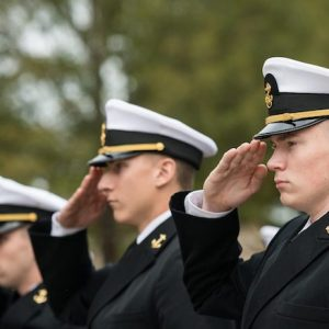 Navy ROTC midshipmen salute during the annual Chancellor's Pass in Review ceremony Nov. 8 in front of the Lyceum. The annual tradition is designed to inspect troop readiness and features cadets and midshipmen from the UM Army, Navy/Marine and Air Force ROTC programs. Photo by Megan Wolfe