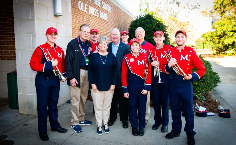UM alumnus and former band member Sumner Spradling has made the lead gift that will help begin construction of a new director's tower that will bear his name. Pictured are (from left) Matt Louis of Corinth, Mississippi, Ole Miss band director David Willson, Matt Smith of Flowood, Mississippi, donors Risa and Sumner Spradling, Wil Stacy of Southaven, Mississippi, Francena Sekul of Biloxi, Mississippi, UM development officer Ron Wilson, Richard Springer of Biloxi, and Max Warren .