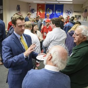 Andrew Newby (left), assistant director for Veteran and Military Services, speaks with guests at the opening of the Veterans Resource Center. Newby has implemented several new services that have helped Ole Miss rise in the rankings among public institutions for supporting military veteran students. Photo by Thomas Graning