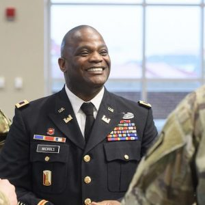 Col. Kelvin Nichols greets fellow Mississippi Army National Guardsmen after a ceremony to promote him to colonel. Nichols has been employed by the University of Mississippi for 25 years. Photo by Thomas Graning
