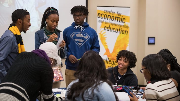 Students from Greenville High School compare notes on their group project during the STRIVE! Conference at the UM Jackson Avenue Center. Photo by Megan Wolfe