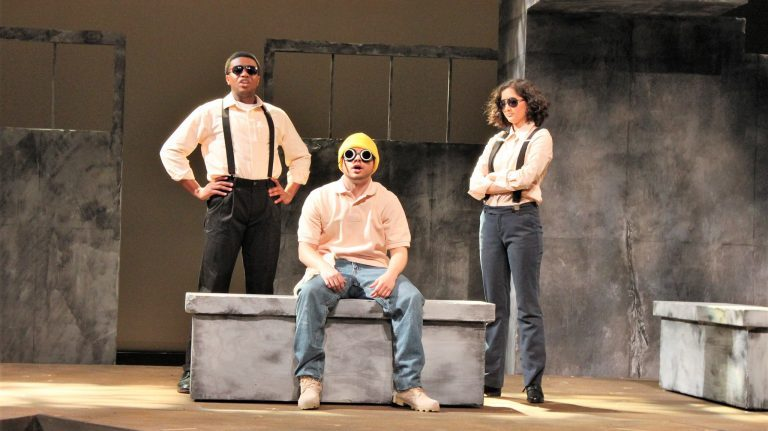 UM students Allen Dillon (left), Keeton Landfair and Meghan Tanaka star in Ole Miss Theatre's production of 'Mr. Burns, a post-electric play.' This scene is a recreation of the classic 'Simpsons' episode 'Cape Feare,' with Landfair portraying Homer Simpson. Photo by Katherine Stewart
