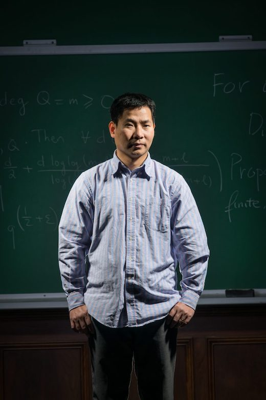 UM assistant professor of mathematics Dao Nguyen holds a gold medal in International Math Olympiad, which he won as a high school student on the Vietnam team in 1992. Photo by Megan Wolfe/Ole Miss Digital Imaging Services