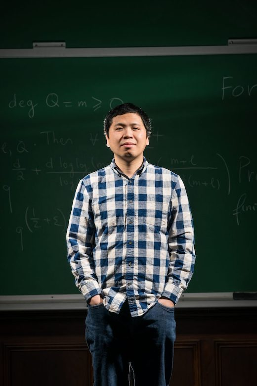 UM assistant professor of mathematics Thái Hoàng Lê holds a gold medal in International Math Olympiad, which he won as a high school student on the Vietnam team in 1999. Photo by Megan Wolfe