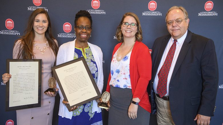 Krista Oliver (left), Karen T. Peairs, Anne Cafer and David Calder celebrate after being honored with Algernon Sydney Sullivan Awards at the 2019 Celebration of Service, hosted by the University of Mississippi Division of Diversity and Community Engagement. The annual awards, the university's highest honor recognizing service, recognize students, faculty, staff and community members who demonstrate selfless service to others. Photo by Thomas Graning