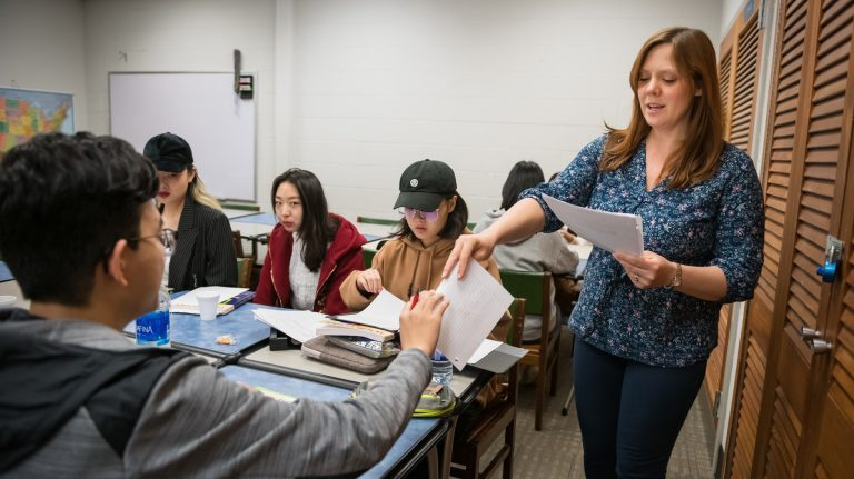 Ashley Fly (right), a UM Intensive English Program instructor, leads a class designed to help non-native English speakers learn both language and cultural skills. Photo by Megan Wolfe/