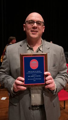 John Young shows off his plaque as the university's 2019 Elsie M. Hood Teacher of the Year. Photo by Kevin Bain/Ole Miss