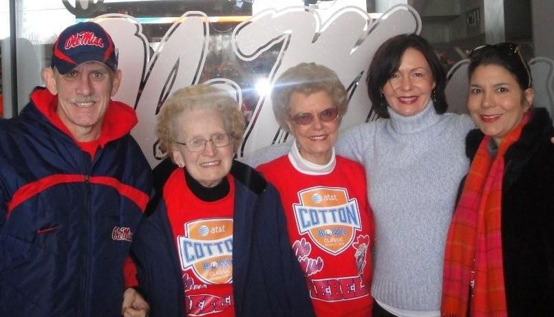 The late Cora Mitchell (second from left) is surrounded by friends and family at an Ole Miss football game: (from left) son Lance Mitchell, the donor, sister-in-law Helen Thomasson, family friend Marion Brown and niece Pat Thomasson.