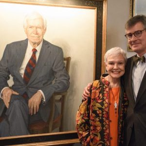 Kay Cochran and artist Jason Bouldin present Sen. Thad Cochran's portrait that has been installed in the University of Mississippi research center bearing the senator's name. Photo by Thomas Graning/