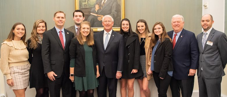 The UM Haley Barbour Center for the Study of American Politics recently sent seven students to Washington to network and get an up-close view of national politics. Gathering in the nation's capital are (from left) Julia Johnson, Abby York, U.S. Rep. Michael Guest, Joseph Haney, Bailey Griffin, U.S. Sen. Roger Wicker, Cally Perkins, Krista Perkins, Shelby Maynor, former Gov. Haley Barbour and professor Conor Dowling.