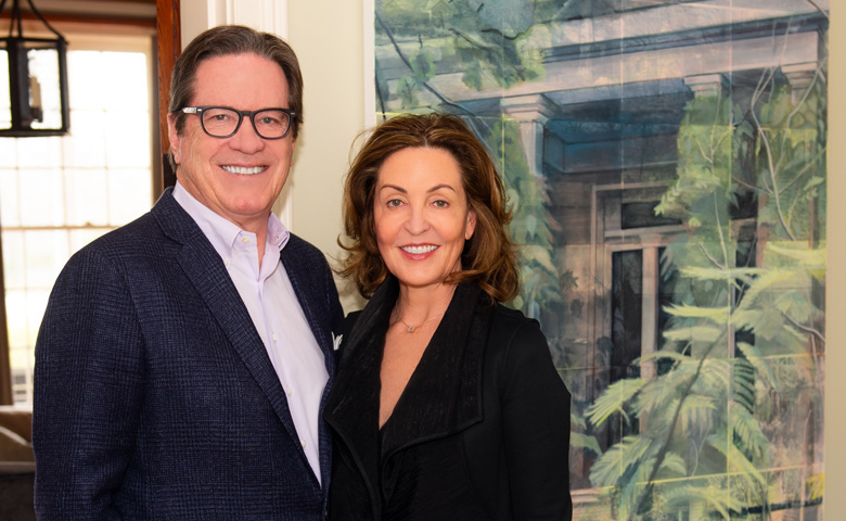 Elizabeth and Will Galtney have adorned the walls of their home with Mississippi-created art, such as the oil painting behind them by Randy Hayes of Holly Springs.